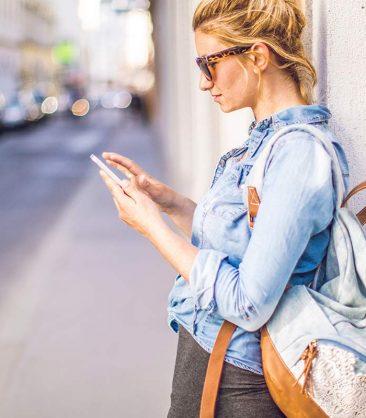 SweetIQ girl searching on phone