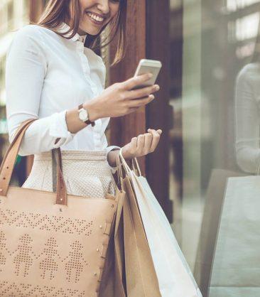 SweetIQ girl shopping looking on phone