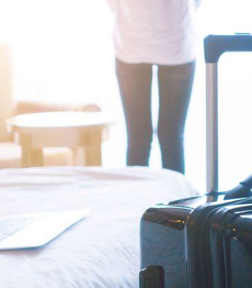SweetIq traveler with luggag