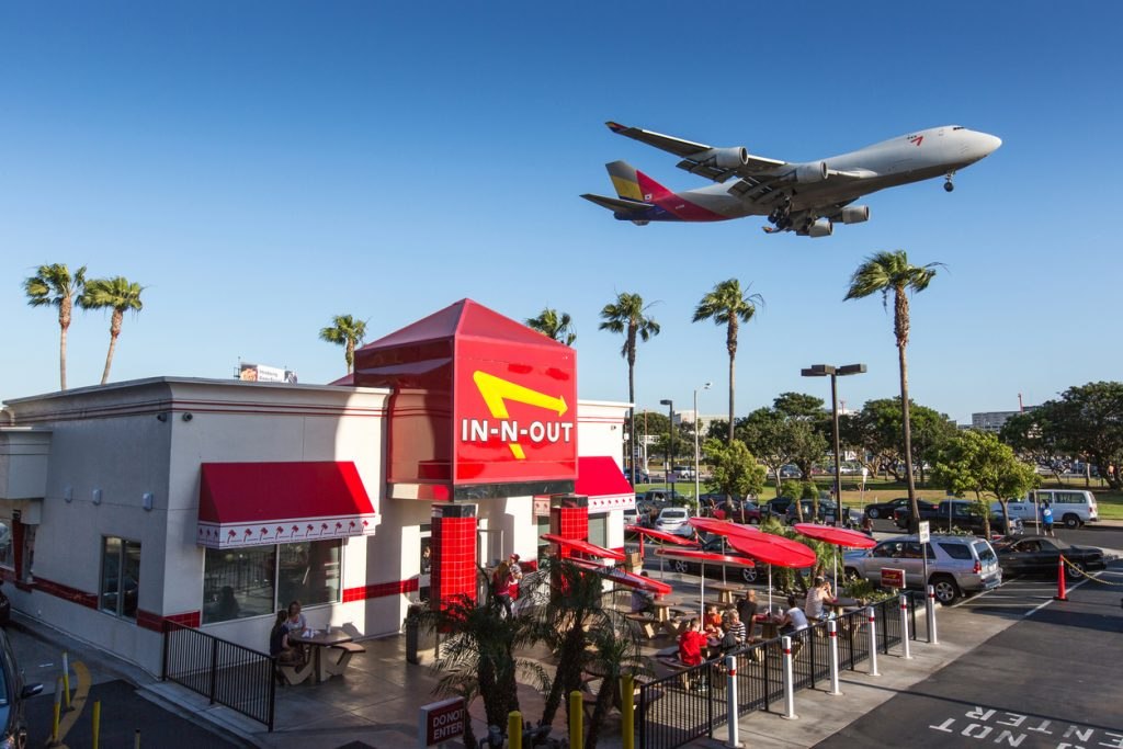 Airplane flying over In-n-Out Burger, LAX
